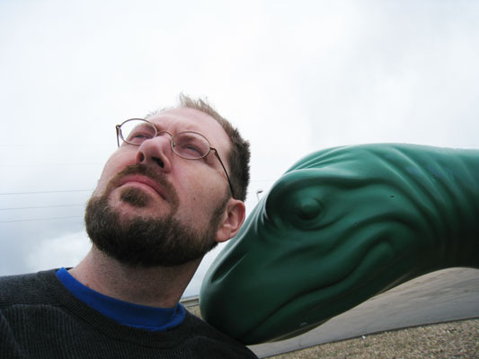 Troy Ehlers chilling with a Sinclair gas station dinosaur